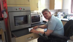 wheelchair user in kitchen